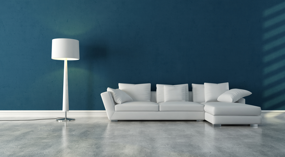 White couch in a stylish living room with concrete flooring