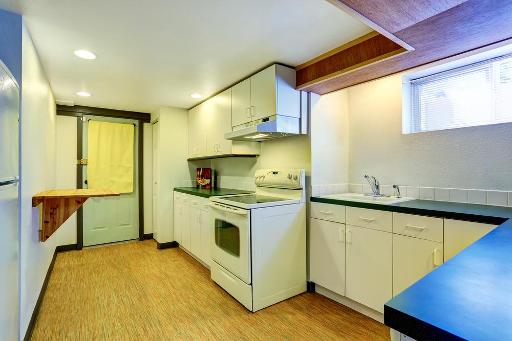 Basement kitchen with linoleum flooring