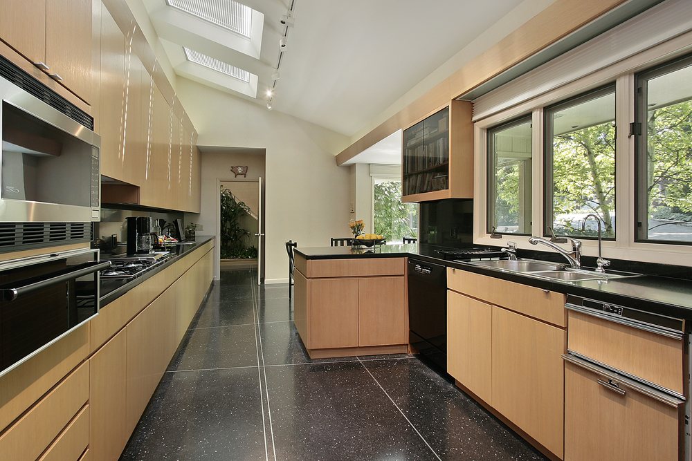 Interior of a kitchen with natural stone flooring